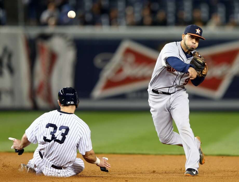 Marwin Gonzalez of the Astros tries to turn a double play while playing the Yankees.