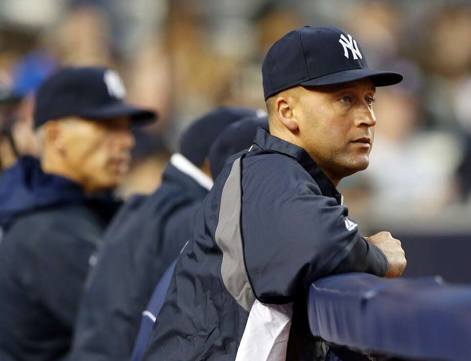 Injured Yankees shortstop Derek Jeter watches his team play the Astros.