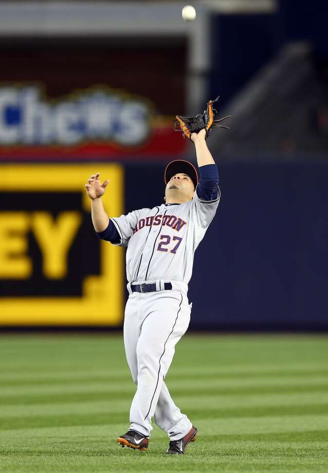 Jose Altuve of the Astros catches a ball for an out during the second inning. Photo: Elsa, Getty Images