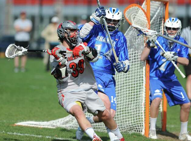 Niskayuna's Mike D'Amario, left, is defended by Shaker's Pat Evans during a lacrosse game on Tuesday, April 30, 2013 in Niskayuna, N.Y.  (Lori Van Buren / Times Union) Photo: Lori Van Buren / 10022215A
