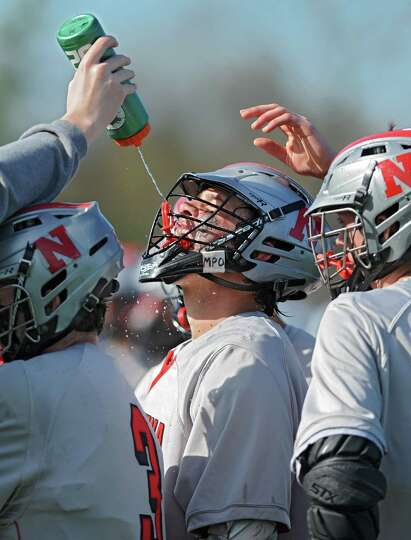 Niskayuna's Aiden O'Brien gets a drink of water during a time out moments before he scored in a lacr