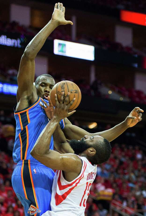 Thunder defenders such as Serge Ibaka, left, are zeroing in on Rockets guard James Harden, who is shooting 36.4 percent from the field in the series and is only 4-of-25 on 3-pointers. He also struggled with turnovers in Game 4, committing 10 to give him 20 for the series. Photo: Smiley N. Pool, Staff / © 2013  Houston Chronicle