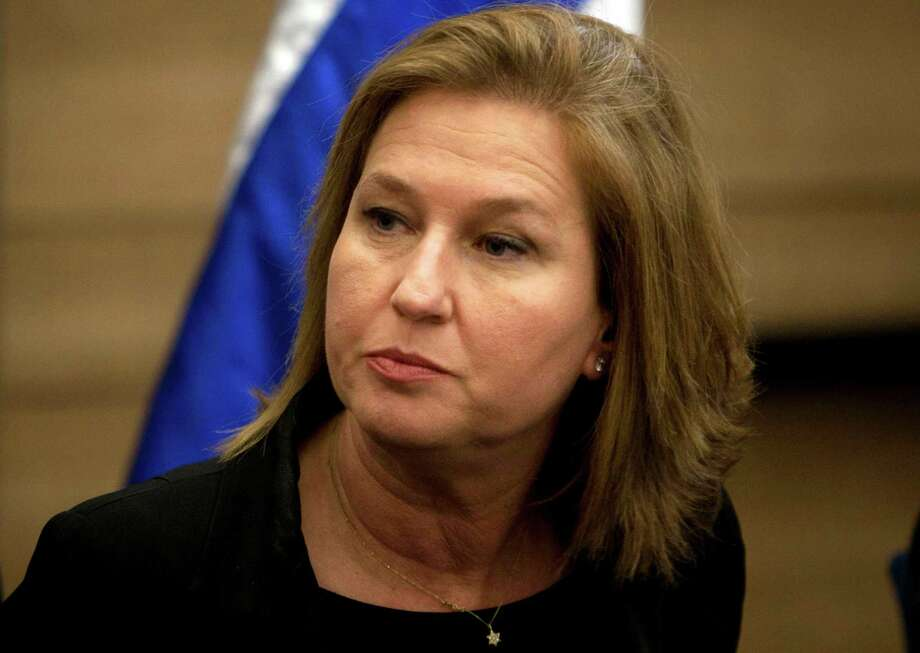 "FILE - In this Wednesday, Nov. 30, 2011 file photo, former Israeli Foreign Minister Tzipi Livni attends a news conference at the Knesset, Israel's parliament, in Jerusalem. The Arab League's decision to sweeten its decade-old proposal offering comprehensive peace with Israel has placed Prime Minister Benjamin Netanyahu in a bind and swiftly exposed fissures in his new government. ""This is a positive announcement,"" negotiator Tzipi Livni told Channel 10 TV, adding it gave ""tail wind"" to peace efforts. ""At the end you need a direct negotiation between the Israelis and the Palestinians."" (AP Photo/Sebastian Scheiner, File) Photo: Sebastian Scheiner"