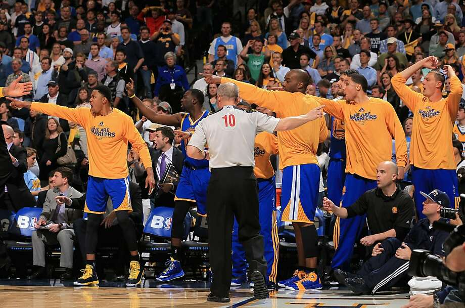 The Warriors' bench and referee Ron Garretson signal in opposite directions as he makes a call in favor of Denver in the Nuggets' Game 5 win. Photo: Doug Pensinger, Getty Images