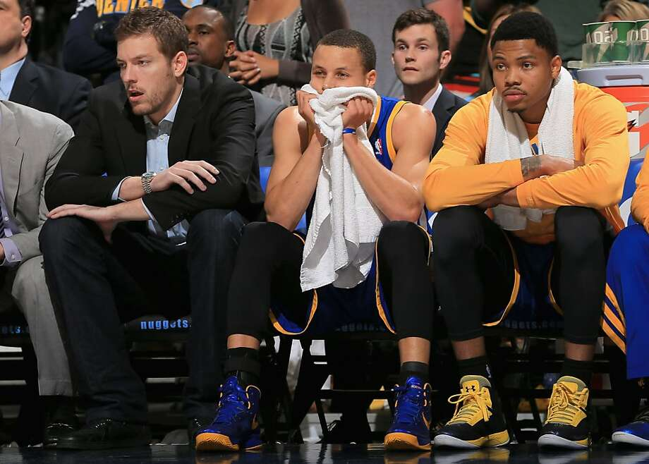 DENVER, CO - APRIL 30:  (L-R) David Lee #10, Stephen Curry #30 and Kent Bazemore #20 of the Golden State Warriors during Game Five of the Western Conference Quarterfinals of the 2013 NBA Playoffs at the Pepsi Center on April 30, 2013 in Denver, Colorado. The Nuggets defeated the Warriors 107-100. NOTE TO USER: User expressly acknowledges and agrees that, by downloading and or using this photograph, User is consenting to the terms and conditions of the Getty Images License Agreement.  (Photo by Doug Pensinger/Getty Images) Photo: Doug Pensinger, Getty Images