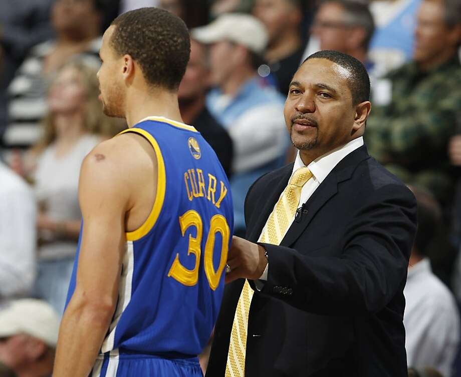 Golden State Warriors head coach Mark Jackson, right, consoles guard Stephen Curry as Curry is pulled late in their 107-100 loss to the Denver Nuggets in Game 5 of their first-round NBA basketball playoff series, Tuesday, April 30, 2013, in Denver. (AP Photo/David Zalubowski) Photo: David Zalubowski, Associated Press