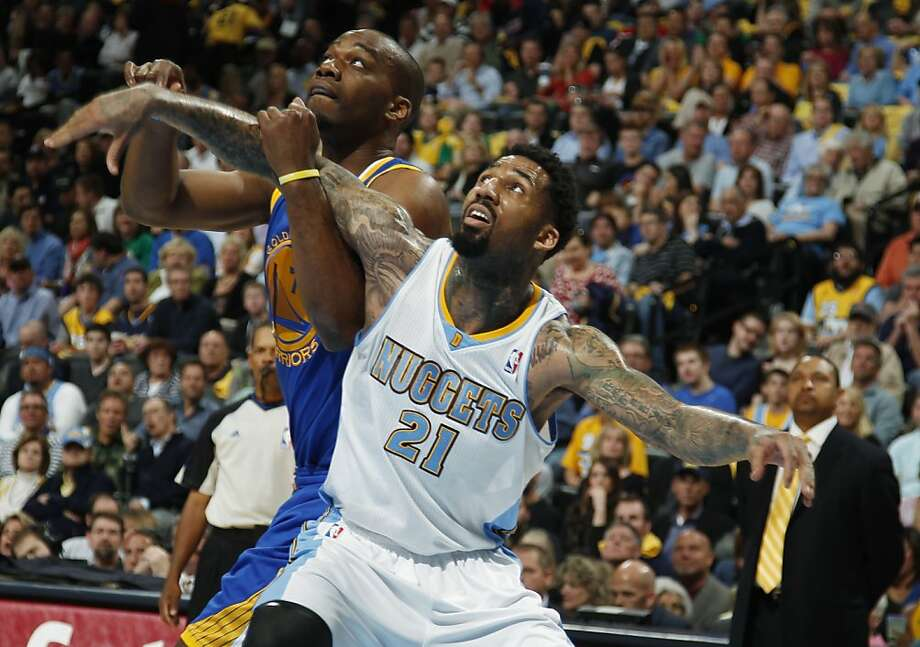Golden State Warriors forward Carl Landry, left, battles for position for a rebound with Denver Nuggets forward Wilson Chandler during the first quarter of Game 5 of their first-round NBA basketball playoff series, Tuesday, April 30, 2013, in Denver. (AP Photo/David Zalubowski) Photo: David Zalubowski, Associated Press