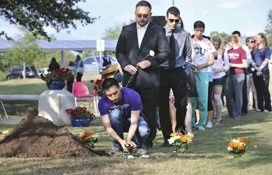 Students at the University of Texas Health Science Center were among the 150 people who came to the campus' Memorial Park to commemorate the lives of people who gave their bodies for research at the school. Photo: Tom Reel / San Antonio Express-News