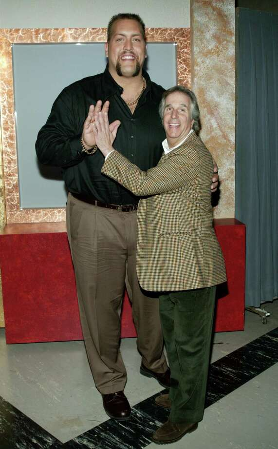 Henry Winkler, aka Barry Zuckerkorn, pictured with professioinal wrestler Big Show in 2003. Photo: Frederick M. Brown, Getty Images / 2003 Getty Images