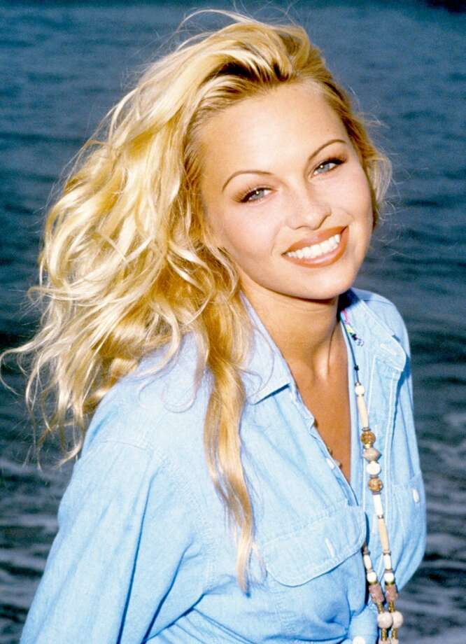 After being discovered in Vancouver, Pamela Anderson did her first Playboy cover in 1989. She\'s pictured in 1993.