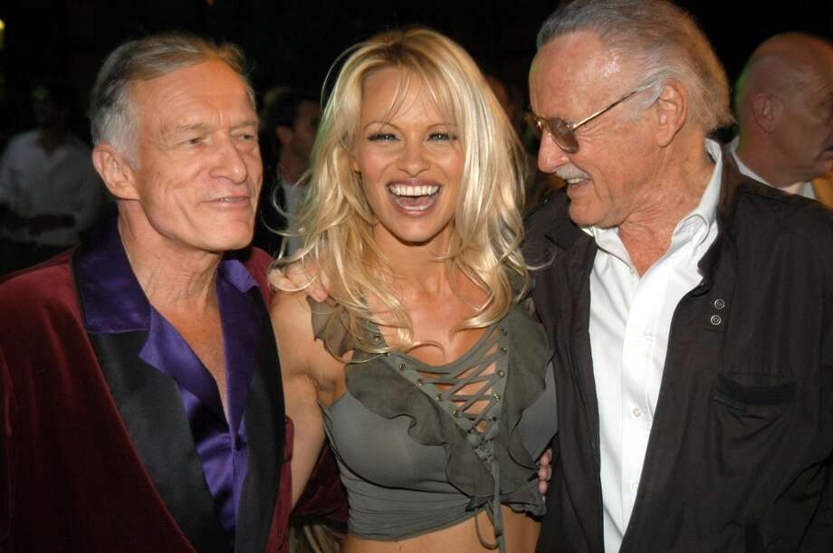 Pamela Anderson with Hugh Hefner, left, and Stan Lee, right, in 2003. Anderson has been on the Playboy cover more times than any other model.