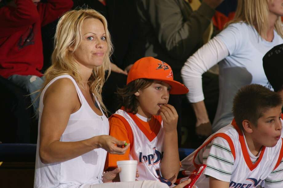 Pamela Anderson with her son (in orange cap) at a college basketball game in Los Angeles in 2008.