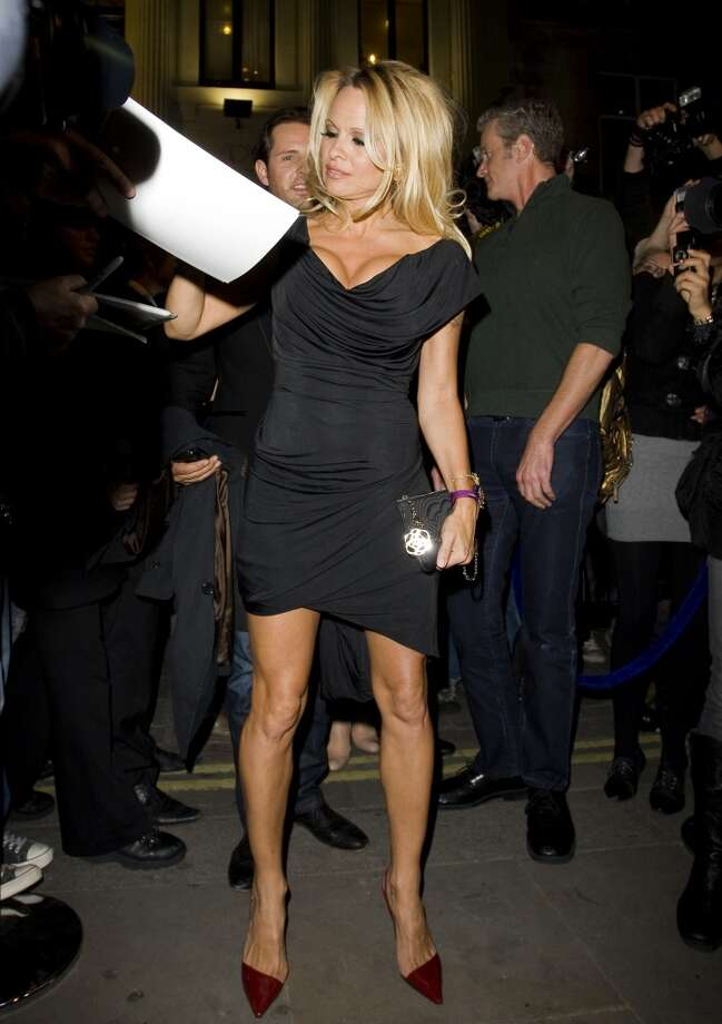 Pamela Anderson signs autographs in 2010, at \'\'The Commuter\'\' premiere in London.
