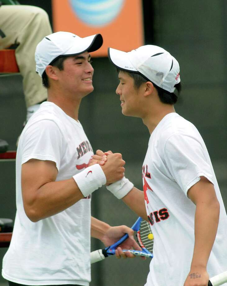 Memorial High School seniors Grant Reichmann, from left, and William Jou celebrate their 6-2, 6-4 win over teammates Thomas Pecor and Christian Vieira in the Class 5A Boys Doubles final at the UIL Tennis State Championships at Penick-Allison Tennis Center on the campus of the University of Texas at Austin on Tuesday. Photo: Jerry Baker, Freelance
