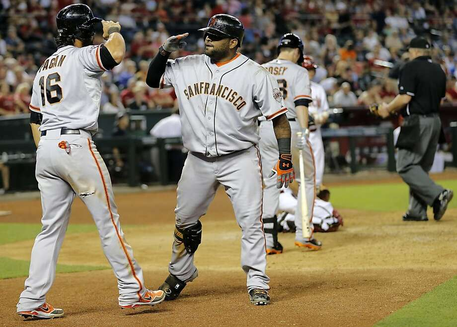 San Francisco Giants' Pablo Sandoval, right, salutes Angel Pagan (16) after hitting a two run home run against the Arizona Diamondbacks during the ninth inning of a baseball game, Tuesday, April 30, 2013, in Phoenix. (AP Photo/Matt York) Photo: Matt York, Associated Press