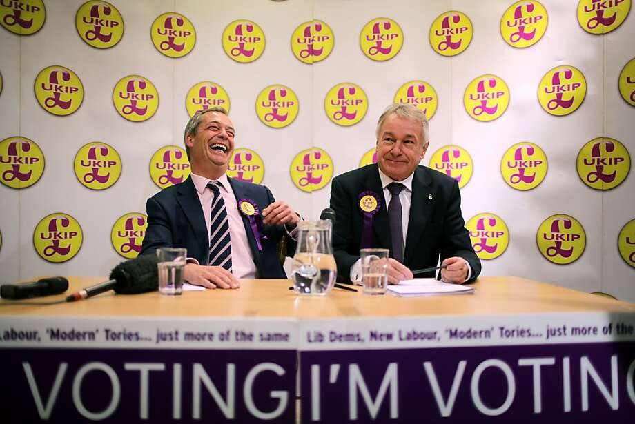 """SOUTH SHIELDS, ENGLAND - APRIL 30:  UK Independence Party (UKIP) Leader Nigel Farage and local candidate Richard Elvin (R) answer questions from the media as he canvasses for votes in the South Shields local elections on April 30, 2013 in South Shields, England. The UK Independence party leader, Nigel Farage, said that his party faced """"one or two teething problems"""" with its 17000 candidates for Thursday's local elections after the suspension of UKIP candidate Alex Wood, who was photographed making a Nazi salute.  (Photo by Christopher Furlong/Getty Images) *** BESTPIX *** Photo: Christopher Furlong, Getty Images"""