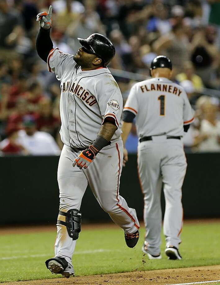 San Francisco Giants' Pablo Sandoval points upward after hitting a two run home run against the Arizona Diamondbacks during the ninth inning of a baseball game, Tuesday, April 30, 2013, in Phoenix. At right is third base coach Tim Flannery. (AP Photo/Matt York) Photo: Matt York, Associated Press