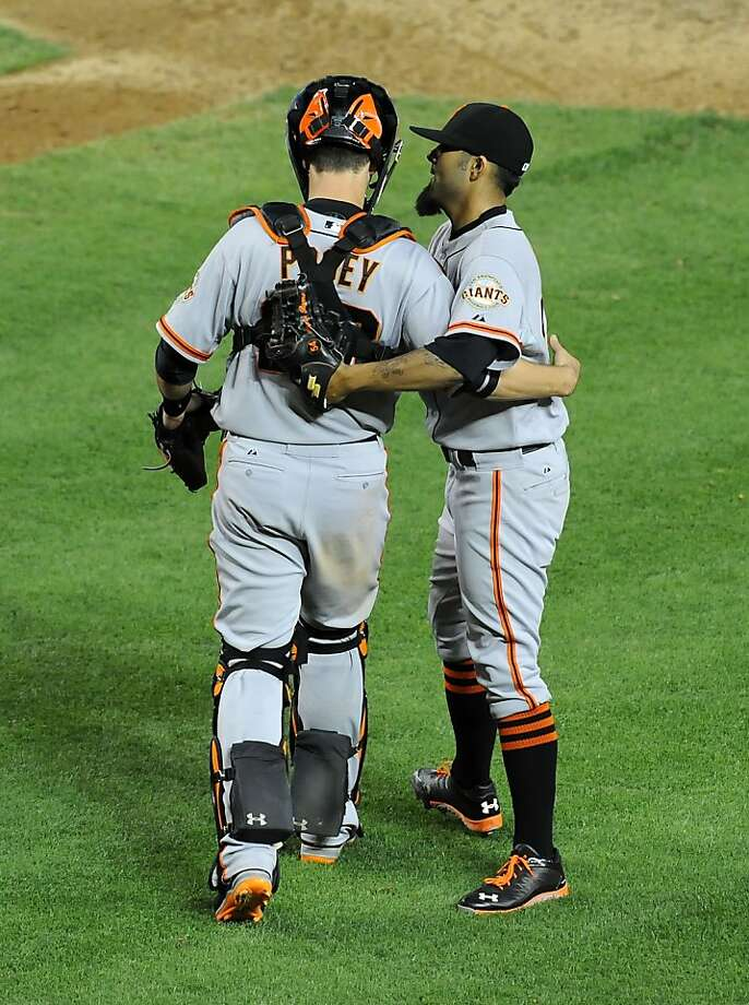PHOENIX, AZ - APRIL 30:  Sergio Romo #54 and Buster Posey #28 of the San Francisco Giants celebrates a 2-1 win against the Arizona Diamondbacks at Chase Field on April 30, 2013 in Phoenix, Arizona.  (Photo by Norm Hall/Getty Images) Photo: Norm Hall, Getty Images