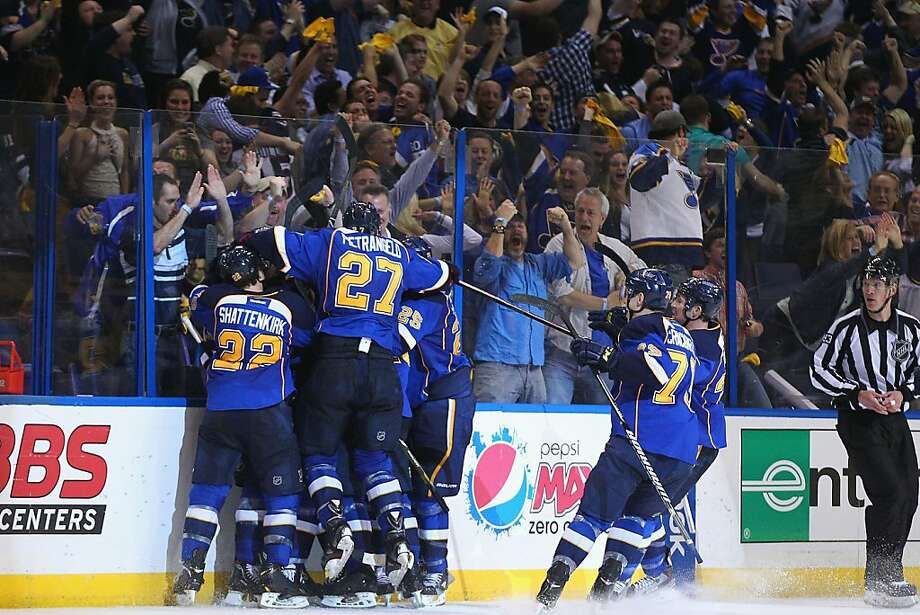 Somewhere pinned beneath a mob of teammates is Alex Steen of the Blues, whose shorthanded goal on a take-away from the Kings' Jonathan Quick gave St. Louis an overtime victory. Photo: Dilip Vishwanat, Getty Images