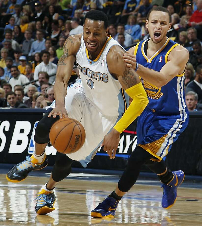 Denver Nuggets guard Andre Iguodala, left, pursues a loose ball with Golden State Warriors guard Stephen Curry in the third quarter of Game 5 of their first-round NBA basketball playoff series, Tuesday, April 30, 2013, in Denver. The Nuggets won 107-100. (AP Photo/David Zalubowski) Photo: David Zalubowski, Associated Press