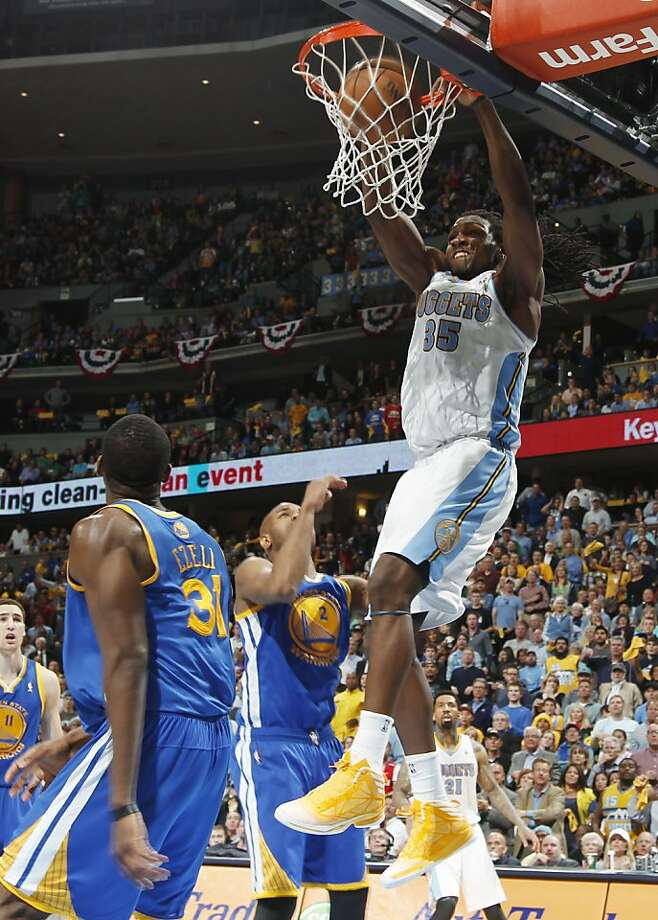 Denver Nuggets forward Kenneth Faried, right, dunks over Golden State Warriors center Festus Ezeli, left, of Nigeria, and guard Jarrett Jack in the fourth quarter of Game 5 of their first-round NBA basketball playoff series, Tuesday, April 30, 2013, in Denver. The Nuggets won 107-100. (AP Photo/David Zalubowski) Photo: David Zalubowski, Associated Press