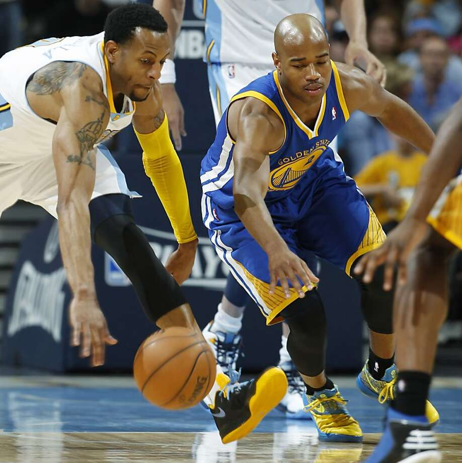 Denver Nuggets guard Andre Iguodala, left, battles for control of a loose ball with Golden State Warriors guard Jarrett Jack in the third quarter of Game 5 of their first-round NBA basketball playoff series, Tuesday, April 30, 2013, in Denver. The Nuggets won 107-100. (AP Photo/David Zalubowski) Photo: David Zalubowski, Associated Press