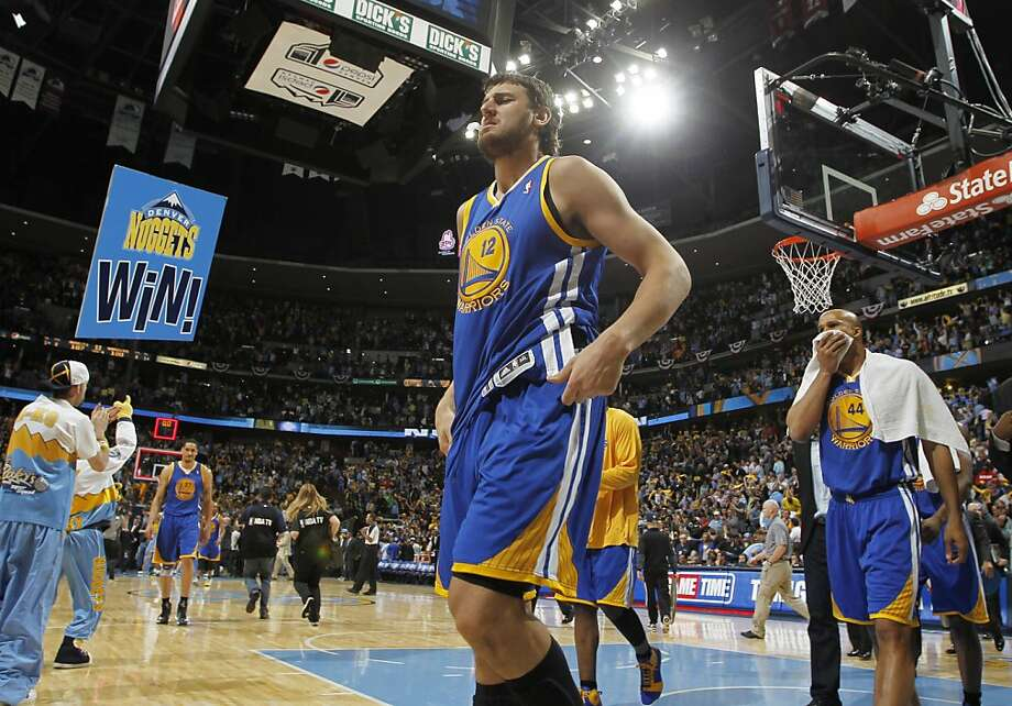 Golden State Warriors center Andrew Bogut (12), of Australia, leads forward Richard Jefferson, right, off the court after their 107-100 loss to the Denver Nuggets in Game 5 of their first-round NBA basketball playoff series, Tuesday, April 30, 2013, in Denver. (AP Photo/David Zalubowski) Photo: David Zalubowski, Associated Press