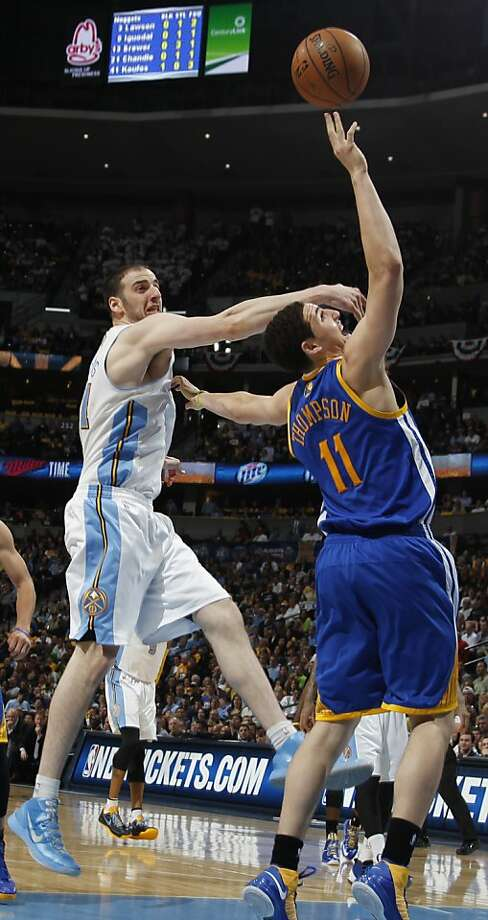 Denver Nuggets forward Kosta Koufos, left, defends as Golden State Warriors guard Klay Thompson shoots in the third quarter of Game 5 of their first-round NBA basketball playoff series, Tuesday, April 30, 2013, in Denver. The Nuggets won 107-100. (AP Photo/David Zalubowski) Photo: David Zalubowski, Associated Press
