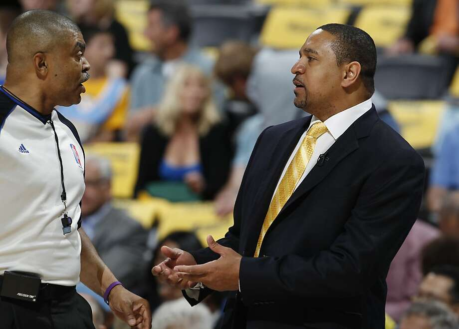 Golden State Warriors head coach Mark Jackson, right, argues a call against his team with referee Tony Brothers during the first quarter of Game 5 of their first-round NBA basketball playoff series against the Denver Nuggets, Tuesday, April 30, 2013, in Denver. (AP Photo/David Zalubowski) Photo: David Zalubowski, Associated Press