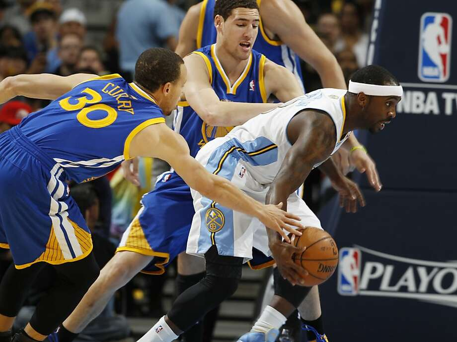 Denver Nuggets guard Ty Lawson, right, scoops up a loose ball as Golden State Warriors guards Stephen Curry (30) and Klay Thompson defend during the first quarter of Game 5 of their first-round NBA basketball playoff series, Tuesday, April 30, 2013, in Denver. (AP Photo/David Zalubowski) Photo: David Zalubowski, Associated Press