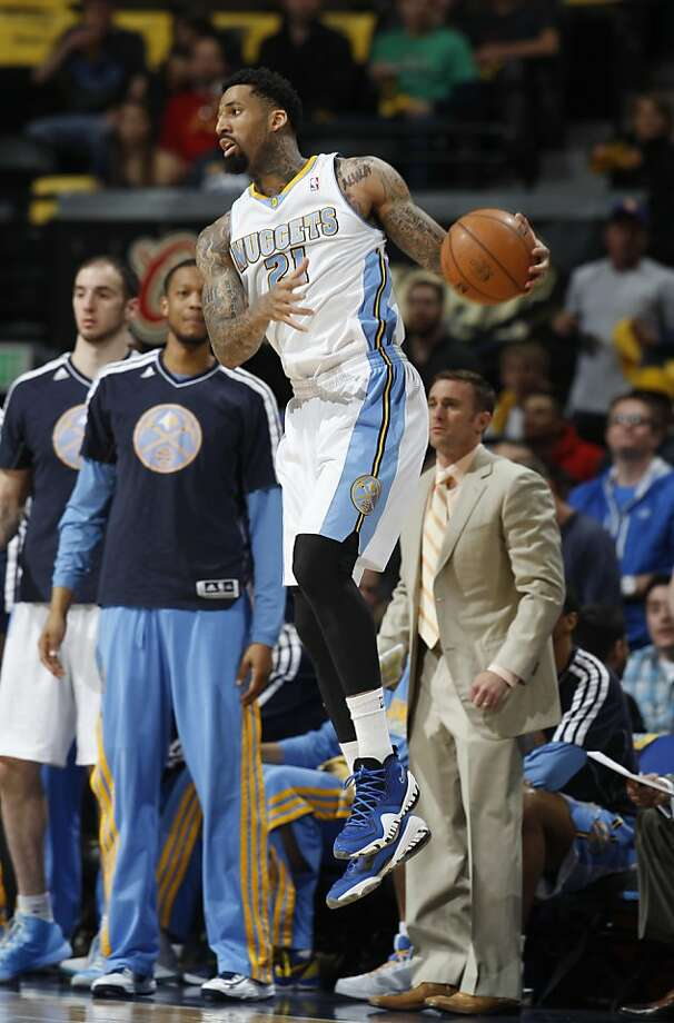 Denver Nuggets forward Wilson Chandler chases down a loose ball against the Golden State Warriors during the first quarter of Game 5 of their first-round NBA basketball playoff series, Tuesday, April 30, 2013, in Denver. (AP Photo/David Zalubowski) Photo: David Zalubowski, Associated Press