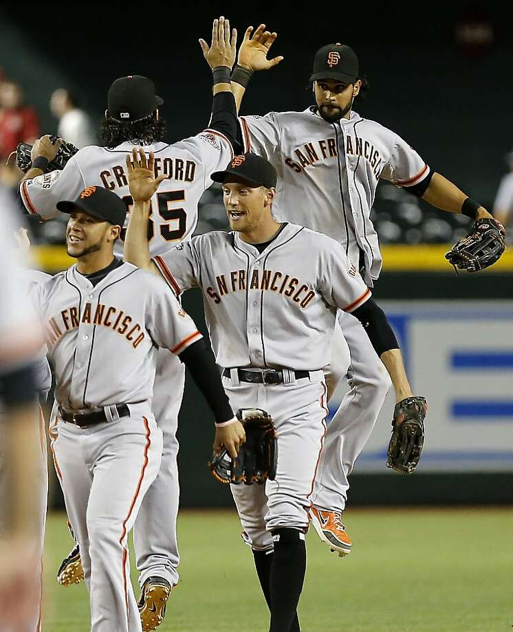 The San Francisco Giants celebrate after the final out against the Arizona Diamondbacks after a baseball game, Tuesday, April 30, 2013, in Phoenix. The Giants won 2-1. (AP Photo/Matt York) Photo: Matt York, Associated Press