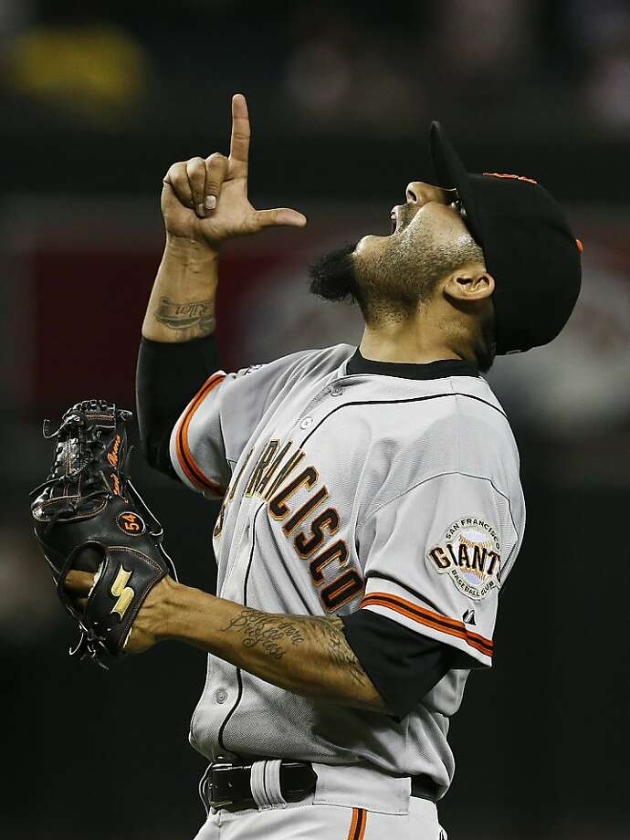 San Francisco Giants' Sergio Romo celebrates the final out during the ninth inning of a baseball game against the Arizona Diamondbacks, on Monday, April 29, 2013, in Phoenix.  The Giants defeated the Diamondbacks 6-4. (AP Photo/Ross D. Franklin) Photo: Ross D. Franklin, Associated Press