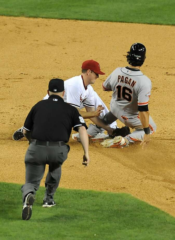 PHOENIX, AZ - APRIL 30:  Angel Pagan #16 of the San Francisco Giants steals second base just ahead of the tag by Josh Wilson #10 of the Arizona Diamondbacks at Chase Field on April 30, 2013 in Phoenix, Arizona.  (Photo by Norm Hall/Getty Images) Photo: Norm Hall, Getty Images
