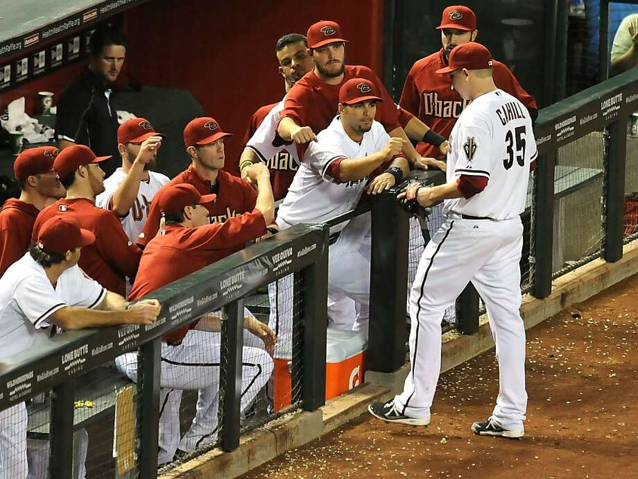 PHOENIX, AZ - APRIL 30:  Trevor Cahill #35 of the Arizona Diamondbacks is congratulated by teammates on the bench after being relieved in the 9th inning against the San Francisco Giants at Chase Field on April 30, 2013 in Phoenix, Arizona.  (Photo by Norm Hall/Getty Images) Photo: Norm Hall, Getty Images