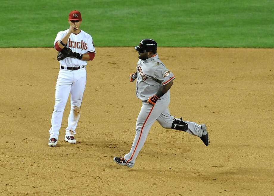 PHOENIX, AZ - APRIL 30:  Pablo Sandoval #48 of the San Francisco Giants rounds the bases after hitting a 2 run home run in the top of the 9th inning as Martin Prado #14 of the Arizona Diamondbacks looks on at Chase Field on April 30, 2013 in Phoenix, Arizona.  (Photo by Norm Hall/Getty Images) Photo: Norm Hall, Getty Images