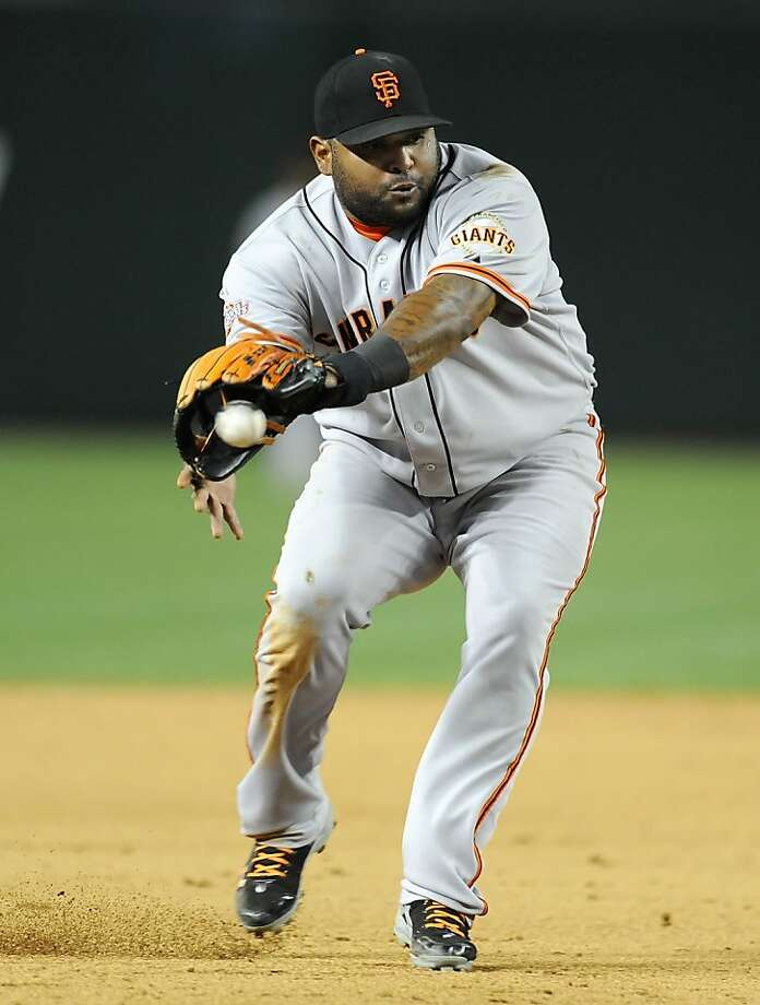 PHOENIX, AZ - APRIL 30:  Pablo Sandoval #48 of the San Francisco Giants makes a backhanded play on a ground ball against the Arizona Diamondbacks at Chase Field on April 30, 2013 in Phoenix, Arizona.  (Photo by Norm Hall/Getty Images) Photo: Norm Hall, Getty Images