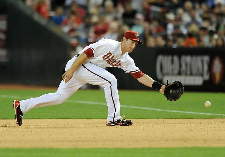 PHOENIX, AZ - APRIL 30:  Paul Goldschmidt #44 of the Arizona Diamondbacks makes a play on a ground ball against the San Francisco Giants at Chase Field on April 30, 2013 in Phoenix, Arizona.  (Photo by Norm Hall/Getty Images) Photo: Norm Hall, Getty Images