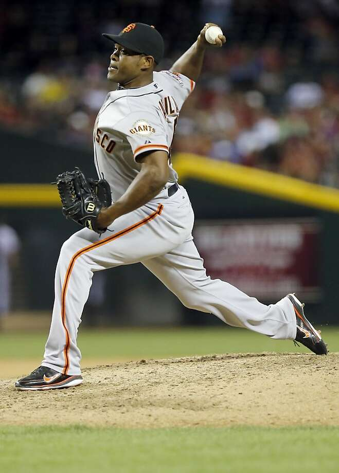 San Francisco Giants pitcher Santiago Casilla delivers a pitch against the Arizona Diamondbacks during the eighth inning of a baseball game, Tuesday, April 30, 2013, in Phoenix. (AP Photo/Matt York) Photo: Matt York, Associated Press