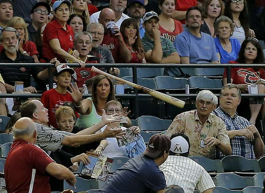 Lumber liquidator:Cody Ross (not seen) inadvertently donates a bat to Diamondbacks fans in the first inning of