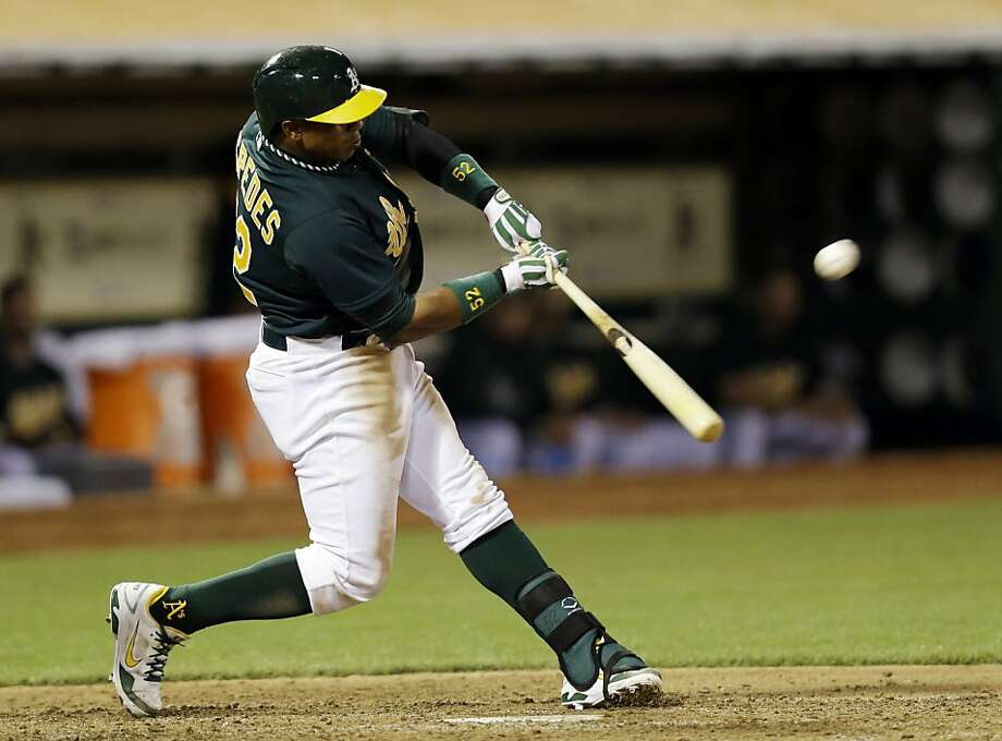 Oakland Athletics' Yoenis Cespedes drives in two runs with a triple against the Los Angeles Angels during the fifth inning of a baseball game on Tuesday, April 30, 2013 in Oakland. Calif. (AP Photo/Marcio Jose Sanchez) Photo: Marcio Jose Sanchez, Associated Press