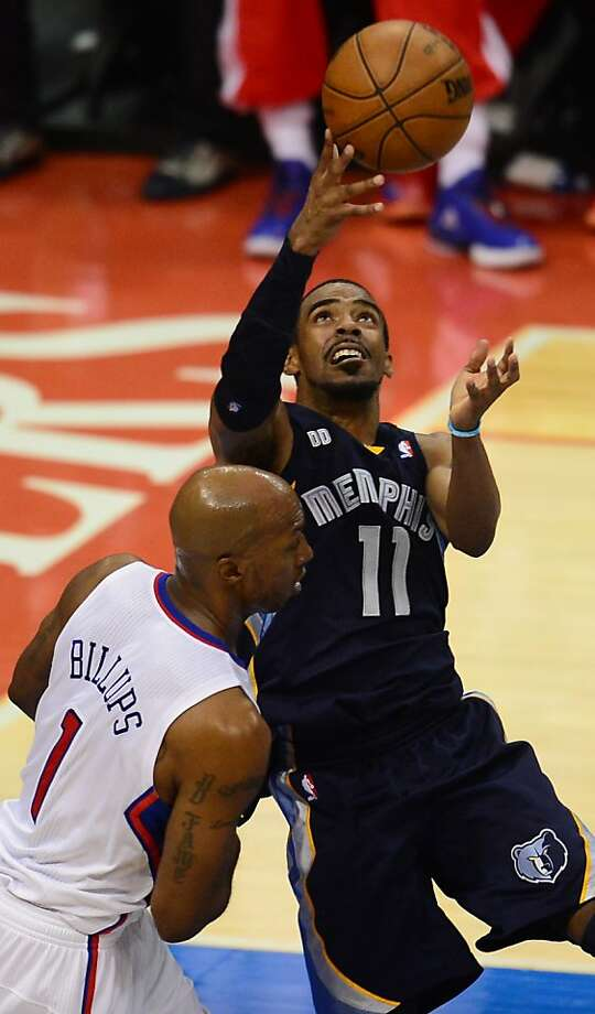 Memphis guard Mike Conley, who scored 20, shoots over Chauncey Billups in the Grizzlies' 103-93 win. Photo: Frederic J. Brown, AFP/Getty Images