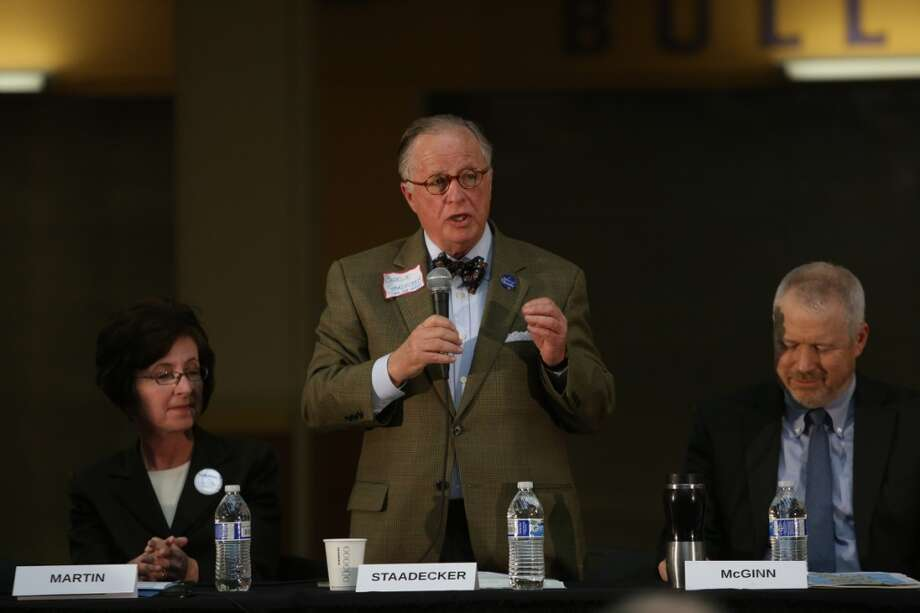 From left, candidates Kate Martin, Charlie Staadecker and Mike McGinn participate in a mayoral education forum on Tuesday, April 30, 2013 at Garfield High School.