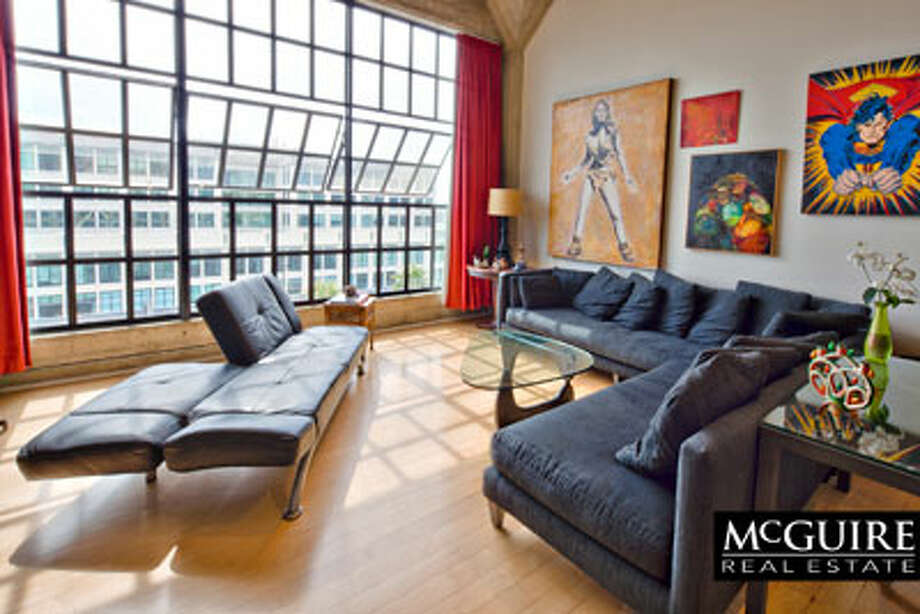 This combined home/office loft in SOMA and near South Beach rents for $6,500. / Winston Wang
