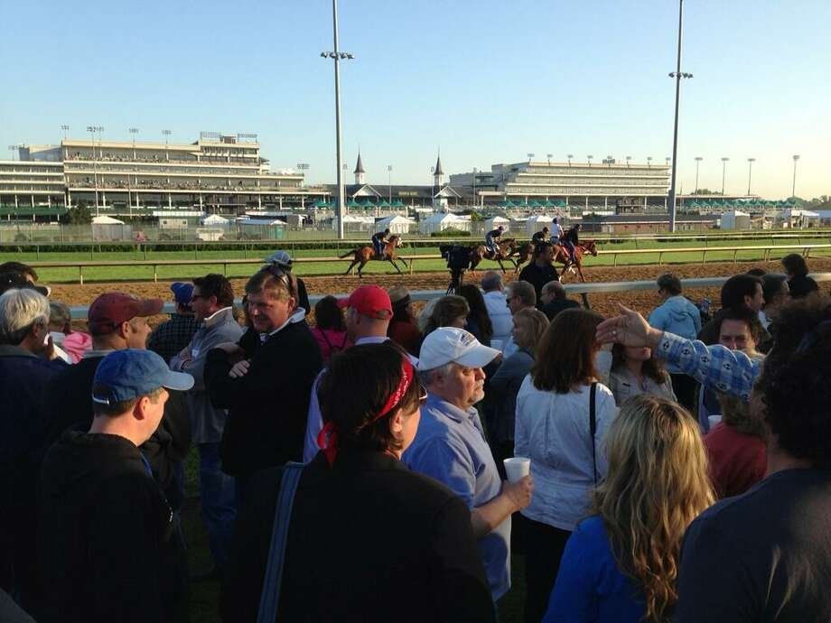The backstretch at Churchill Downs was packed with spectators early Wednesday, May 1, 2013. The Kentucky Derby will be run at the world-famous track on Saturday. (Skip Dickstein / Times Union)