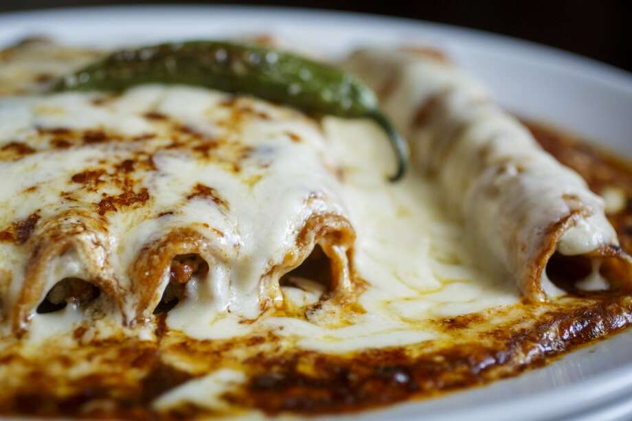The Enchiladas Saltillo Con Pollo at La Casa del Caballo. Photo: Michael Paulsen, Houston Chronicle
