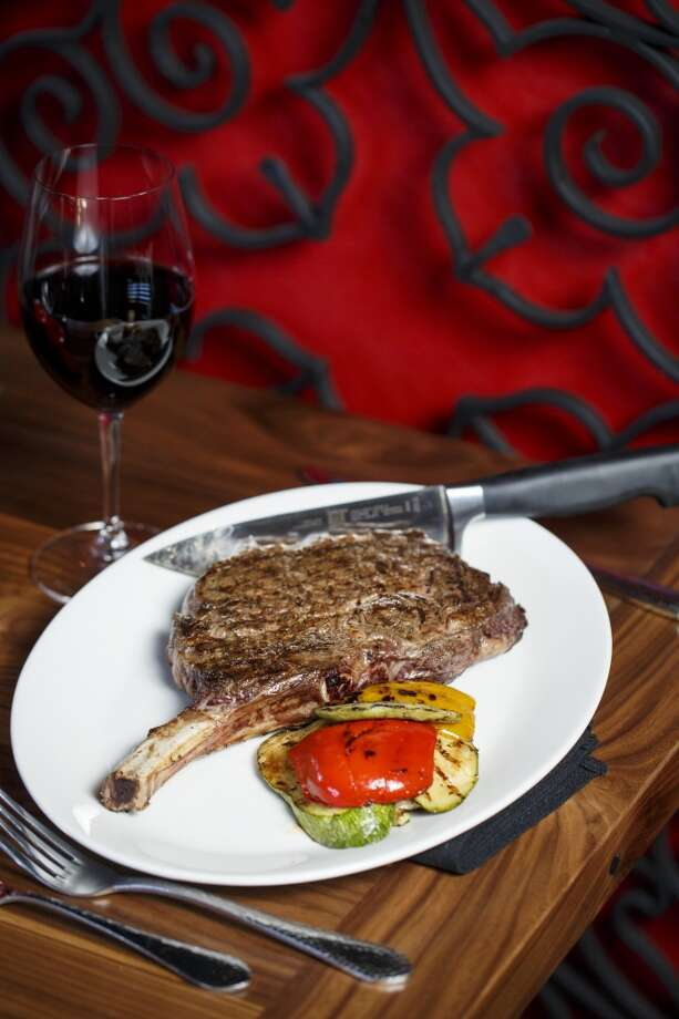 The Cowboy Cut Bone-In Ribeye Steak at La Casa del Caballo. Photo: Michael Paulsen, Houston Chronicle