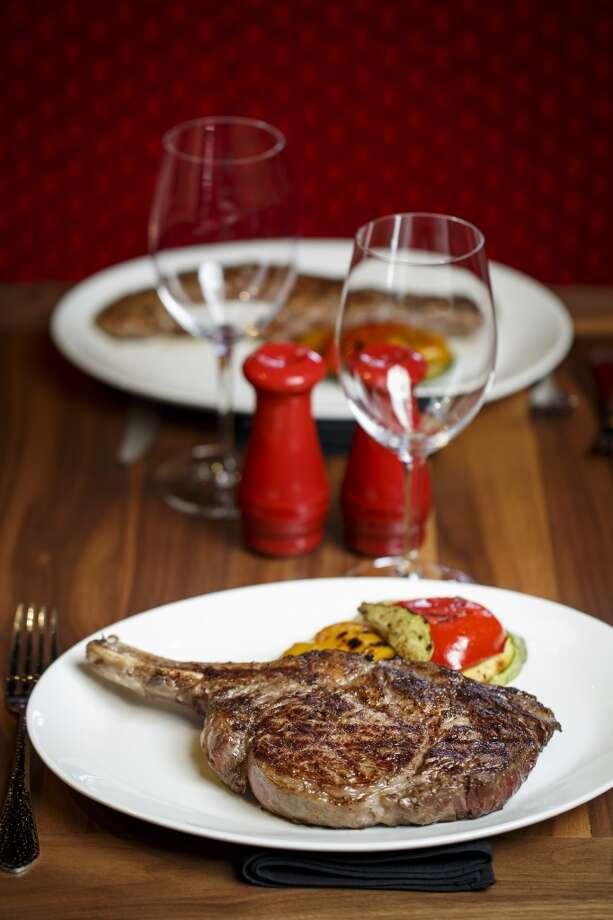 The Cowboy Cut Bone-In Ribeye Steak at La Casa del Caballo. Photo: Michael Paulsen, Houston Chronicle