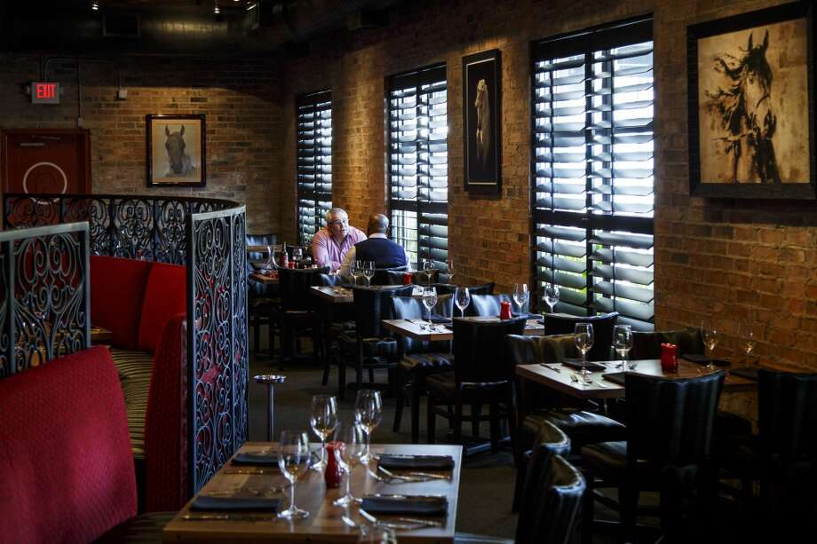 In the dining room at La Casa del Caballo. Photo: Michael Paulsen, Houston Chronicle