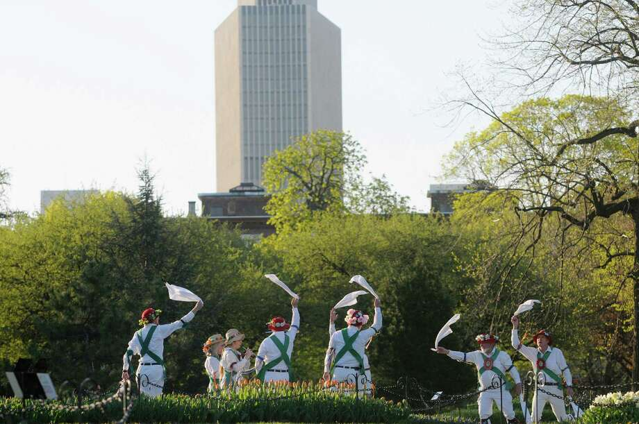 Members of the Pokingbrook Morris Dancers perform traditional display dance of England at Washington Park on Wednesday morning, May 1, 2013 in Albany, NY.  The community dance group was started in 1974 and is dedicated to keeping the living dance traditions of England alive in the Capital District.  The group will be performing on May 11th from 12 to 2pm at the Tulip Festival and then on May 15th at Riverview Orchards in Rexford at 7pm.  (Paul Buckowski / Times Union) Photo: Paul Buckowski
